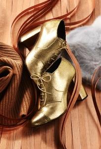 Botines de piel dorados 445€